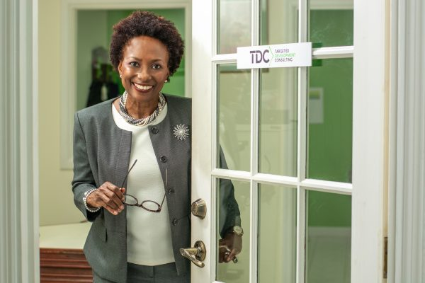 Susan Branker-Greene- opening door at TDC Works office